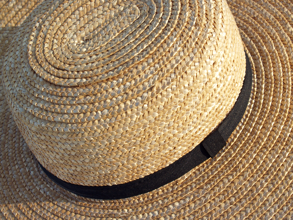 Stock photo of a straw Amish hat.