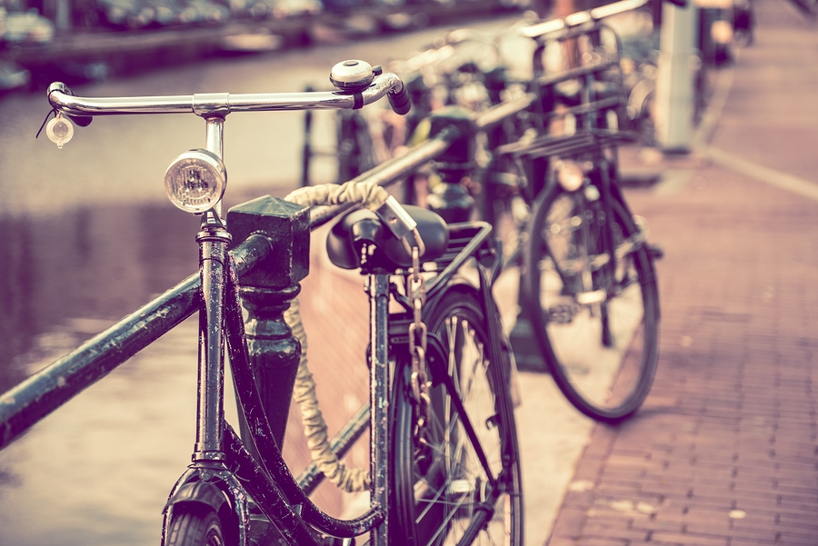 Image of secured old bikes in Amsterdam  by ginton    Pit stop. (Just a friendly reminder to lock up your bike, of course. Besides, we just really love this photo.)