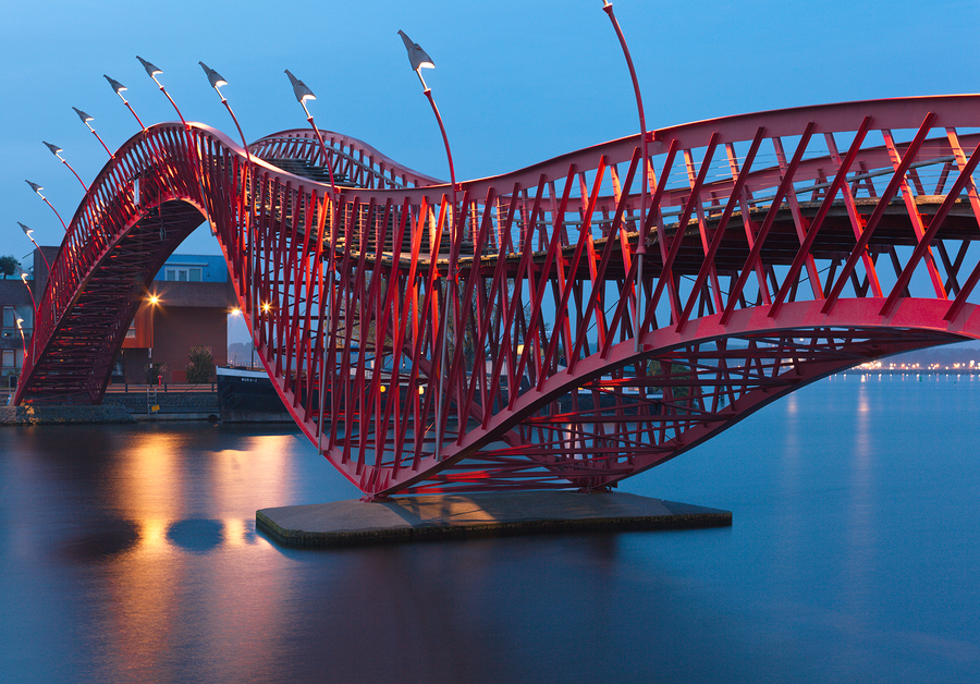 Image of Python Bridge in Amsterdam by alchena   A city'sbridges are not only alandmarkfor the eyes when discovering a new place, but they also serve as a nicebit of history. This is one of the newer bridges of Amsterdam, built in 2001. The Python Bridgewent on to winthe International Footbridge Award in 2002.