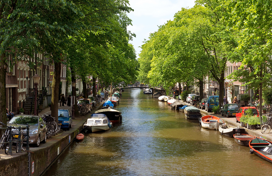 Image of Amsterdam's canals  by Veniamin Kraskov   The canals in Amsterdam are so beautifully integrated into the city - the perfect blend of nature and urban landscape. Stop to take in the views and you might even feel a slight sea breeze. (It can happen.)