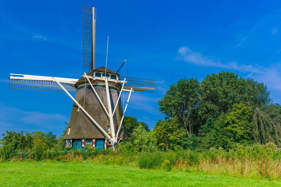 Image of Windmill in Amsterdam  by kavalenkava volha   A break from the urban streets might be good for your lungs, and the windmills are a perfect excuse to get somefresh air. They sit along lush green landscapes and were once an omnipresentpart of life in Holland. And thoughthere were once 10,000 windmills all over the Netherlands, only eight remain in Amsterdam.